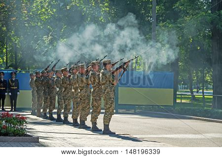 Dnepropetrovsk Ukraine - August 23 2015: Armed forces salute with guns during ceremony of raising Ukrainian national flag