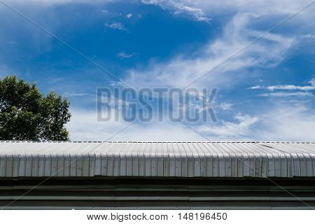 Metal Sheet Roof Building With Blue Sky Background