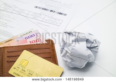 Credit Card On Wallet, Bank Account Statement And Paper Lump