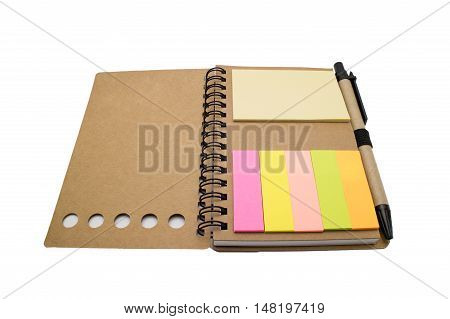 Spiral notebook with colorful post-it note isolated on white background