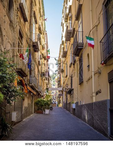 Narrow street in old town of Naples city in Italy