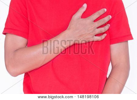 Young man with hand on his chest on white backgournd.