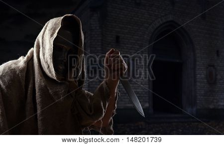 man in iron mask with a big knife