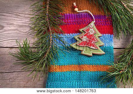 Christmas tree decoration on wooden texture background woolen warm wear texture new year