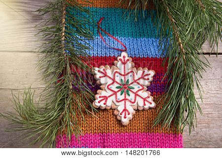 Christmas tree decoration snowflake on wooden texture background woolen warm wear new year
