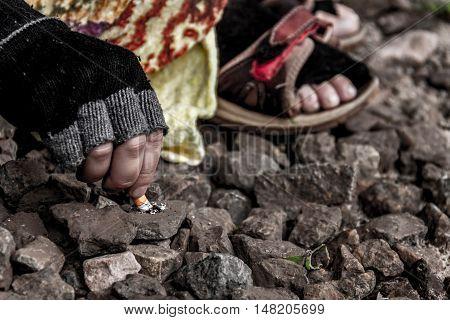 Homeless Crushing Cigarette