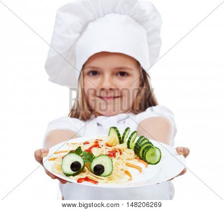 Little chef presenting a plate of pasta - creative food