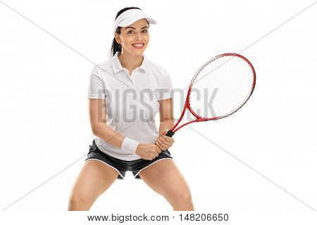 Happy young woman playing tennis isolated on white background