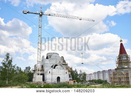 High industrial crane at the construction site of the church