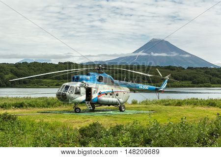 Kamchatka Peninsula, Russia - August 13, 2016: Helicopter on background Kurile lake and Ilyinsky volcano. South Kamchatka Nature Park. View from the helicopter.