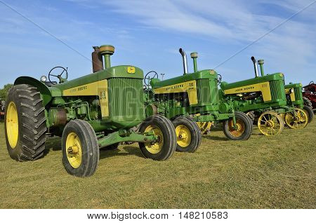 ROLLAG, MINNESOTA, Sept 1. 2016:Vintage John Deere 630, 730, and 830 tractors are displayed at the West Central Steam Threshers Reunion in Rollag, MN attended by 1000's held annually on Labor Day weekend.