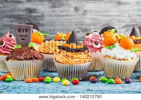 Halloween Cupcakes With Different Colored Mastic Decorations