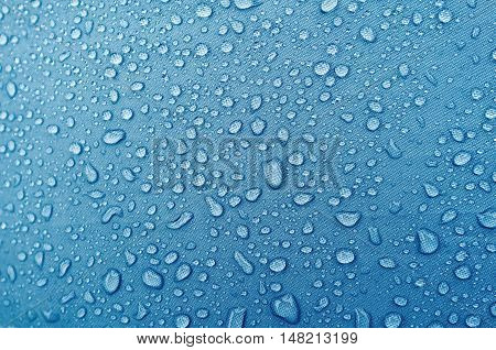 Water Droplets On Blue Fiber Waterproof Fabric.