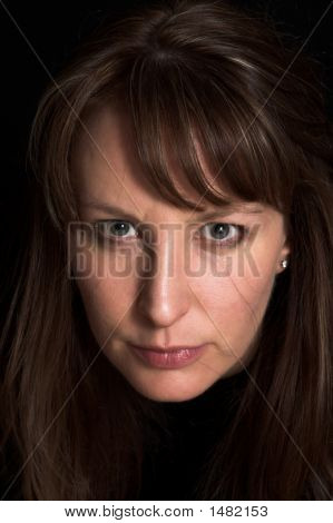 Woman Portrait On Black Backdrop