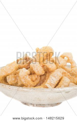 Pork crackling Fried or roasted pork rind and fat isolated on white background