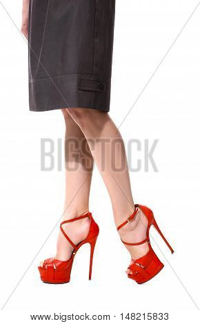long legs in red sandals shoes close up photo isolated on white