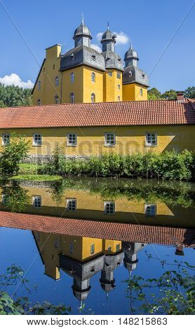 Castle Of Schloss Holte-stukenbrock With Reflection In The Water