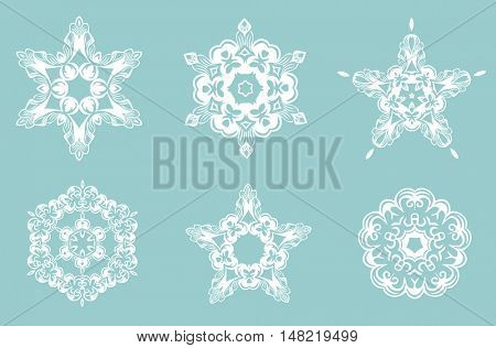 Set of ornate of vector snowflakes, white snowflakes on a blue background. Vintage snowflake.