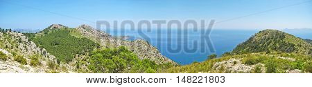 Mountain crest panorama with ocean view - blue sky