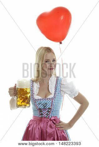 Woman in bavarian Dirndl holding an Oktoberfest  Beer Mug with a red Balloon