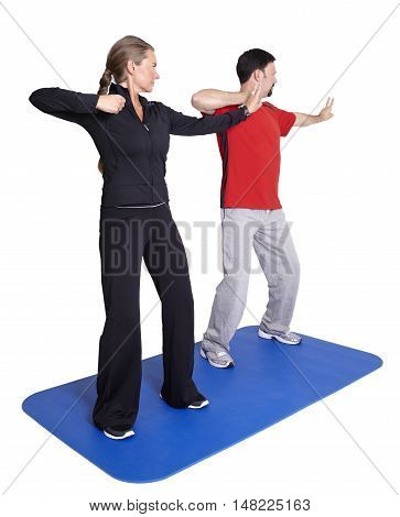 Personal trainer workout with client with white background