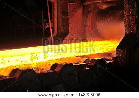 hot steel plate on conveyor in steel plant
