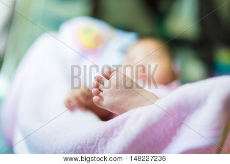 Foot of baby are sleep. healthy, love.