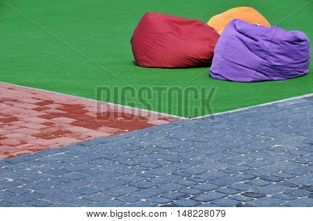 road surfaces and artificial grass with cushions for relaxing