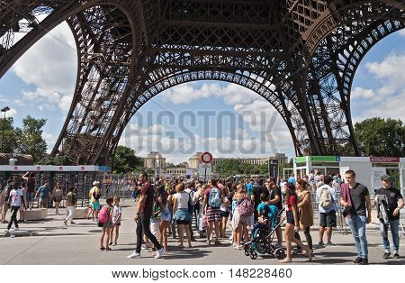 PARIS, FRANCE-AUGUST 09, 2016: tourists at the Eiffel Tower in Paris