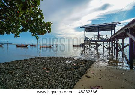 Morning view of the fishing jetty at Tanjung Aru village,Labuan Pearl of Borneo,Malaysia.The fishing industry contributes a significant income to islanders here.