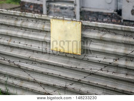 empty signboard on gloomy fence with wire in abandoned Chernobyl