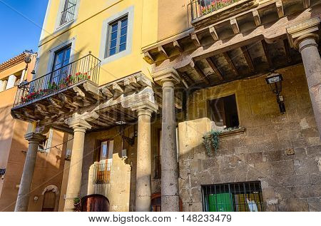Amazing combination of ancient and modern building decoration in Tarragona, summer Spain