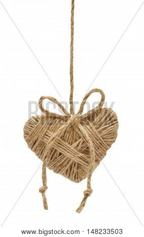 Heart decoration hanging on the ropes isolated on white background