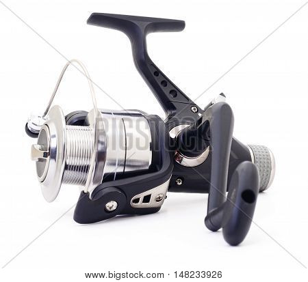 Fishing reel close up isolated on white background.