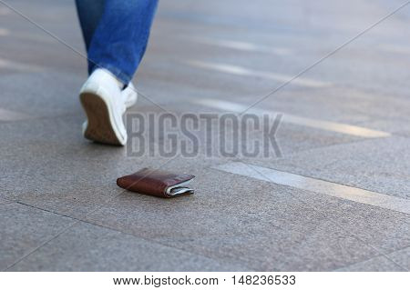 people walking lost leather wallet with money
