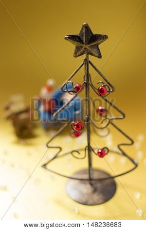 A Christmas tree made of wire and Santa Clause and reindeer