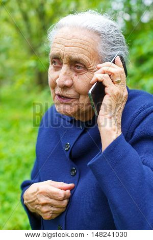 Portrait of a senior woman while talking on the phone