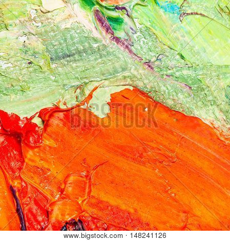 Orange And Green Oil Paint Brush Strokes On Canvas