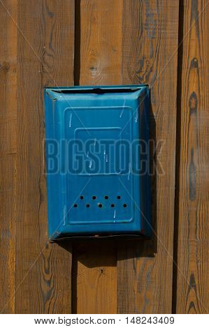 Old soviet postbox on the fence for letters and newspapers
