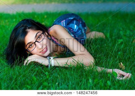 girl lying posing outdoors in the summer
