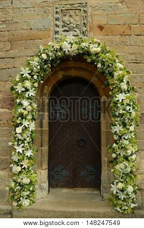 A floral garland around a door at Crichton collegiate church