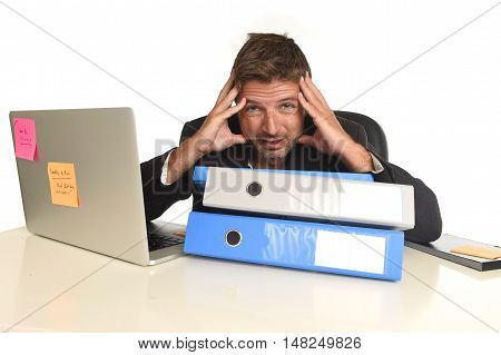 tired and frustrated businessman desperate face expression suffering stress and headache at office computer desk busy with paperwork folders overwhelmed isolated on white background