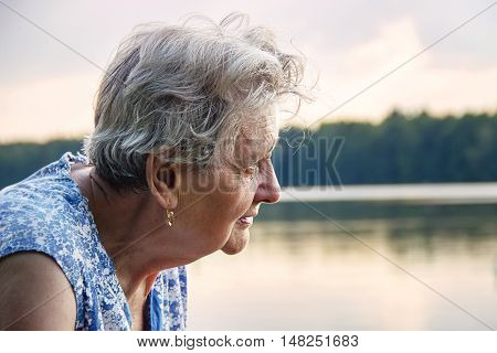 Portrait of a beautiful senior woman outdoors