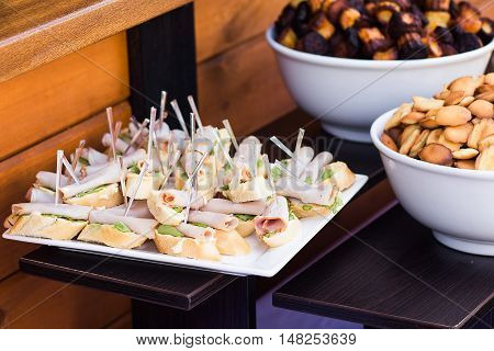 Wood Brown Tables Full Of Different Snacks