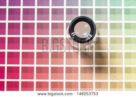 A magnifier on a color chart book