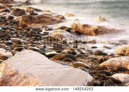 rocks near the shoreline of the beach
