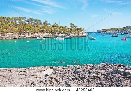 Couple Snorkeling In Clear Turquoise Water