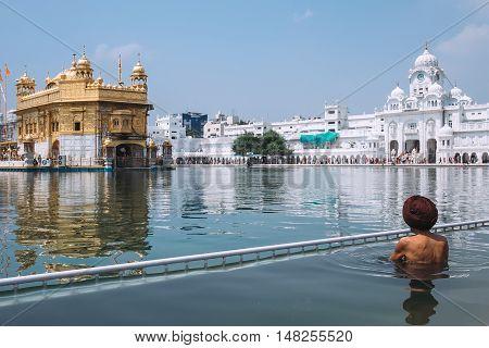 Sikh pilgrim in saint pool in Golden Temple Amritsar