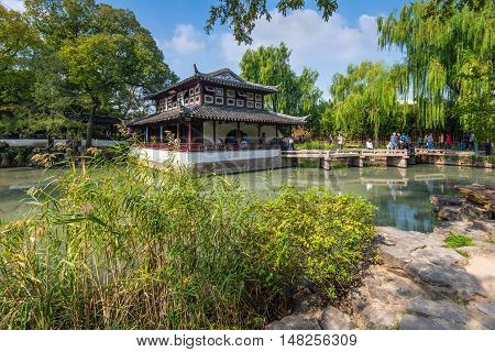 Suzhou China - October 232016: Tourists at the The Humble Administrator's Garden a Chinese garden in Suzhou a UNESCO World Heritage Site.