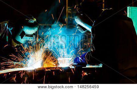 welder welding  Industrial automotive part in car production factory